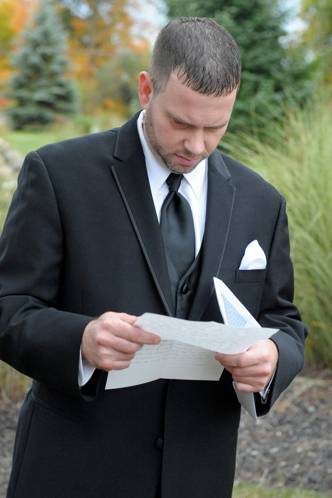 groom_reading_letter