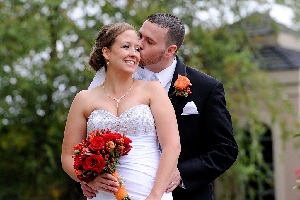 groom_kissing_bride_fall_wedding